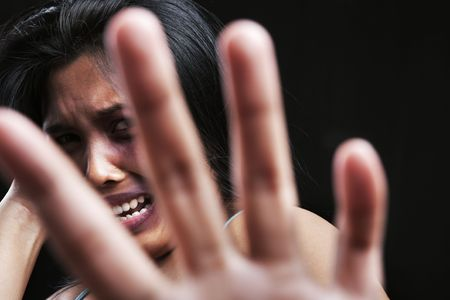 Young woman defending herself, can be used for domestic violence concept photo