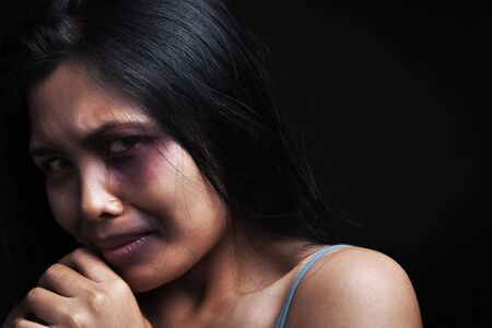 Domestic violence victim, a young Asian woman being hurt Stock Photo - 5836861