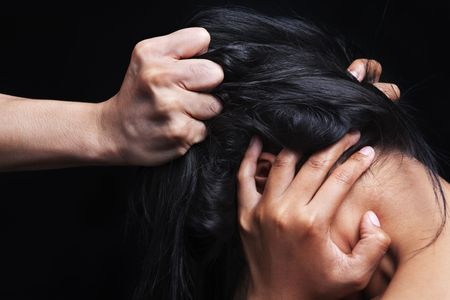 Hand grabbing woman's hair, concept for domestic violence Stock Photo - 5836873