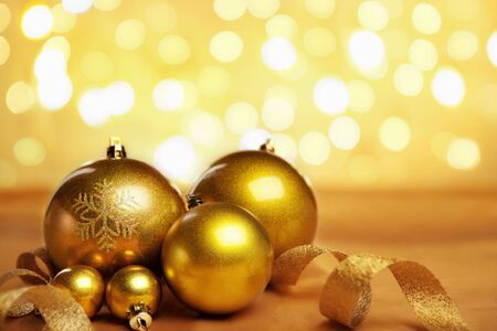Golden Christmas ornaments with blur light on background Stock Photo - 5956174