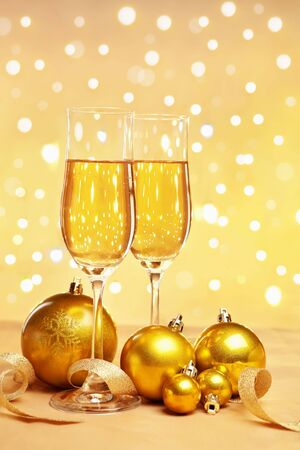 Champagne and golden Christmas ornaments with blur light on background, for Christmas party concept photo