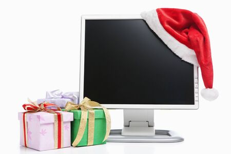 Computer, Santa hat and giftswith blank screen to be inserted with image Stock Photo - 6054744