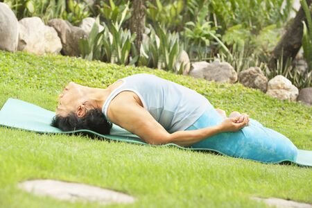 Senior old Asian woman doing yoga in park alone Stock Photo - 6264387