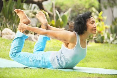 Asian senior old woman practicing yoga at garden Stock Photo - 6264371