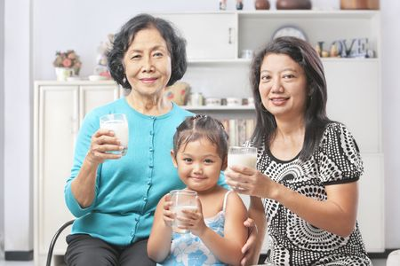 Three Asian female generation holding a glass of milk Stock Photo - 6264305