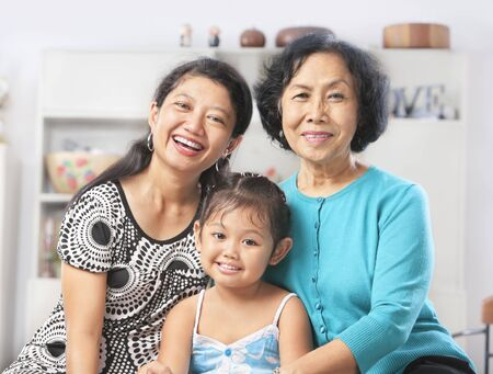 three generation: Three generation of Asian females posing at home. PS: a bit addition to the height by stiching another photo because the original one was in tight crop composition