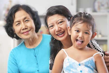 three generation: Three generation of Asian females posing at home starting from grandma, mother and daughter Stock Photo