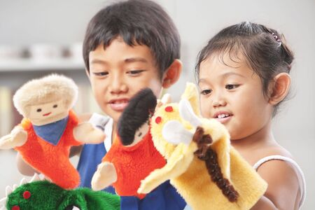were: Sibling playing hand puppets, which were  handmade