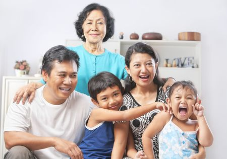 Asian family portrait with their grandmother. PS: stitching image for the tightly crop area of grandma's head make additional height to the image photo