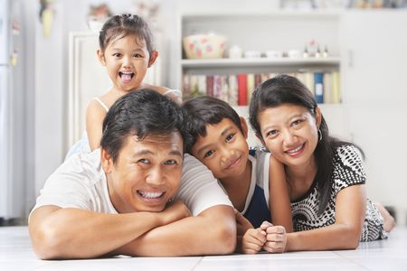 happy asian family: Asian family posing on the floor at home