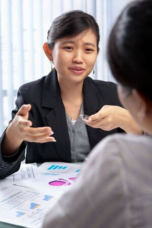 Chinese businesswoman talking to her client in the office photo