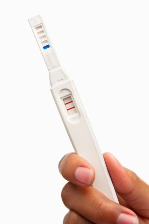 negative area: Hand holding positive result pregnancy test, against white background. You can easily set to negative result by patching the area around the T so only the C area has red strip Stock Photo