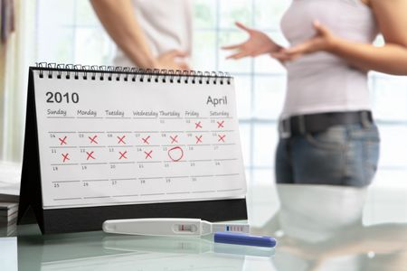 circle calendar date: Couple quarrel with negative pregnancy test, a concept for family having difficulty to have a baby. PS:main focus on the test result Stock Photo