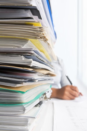 Workload concept with high pile of paperwork. Selective focus Stock Photo - 7284029