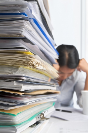 Lots of workload with stress people on background. PS: small depth of field and selective focus on papers Stock Photo - 7283321