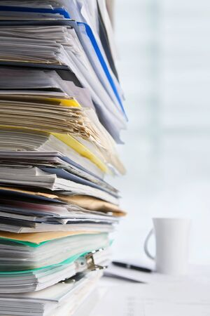 Pile of paperwork with cup and pen on background Stock Photo - 7284021