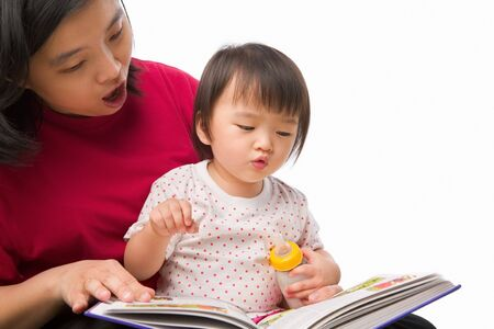 Mother telling a story to her child with book photo