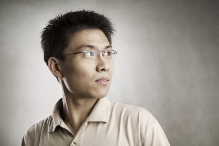 Chinese man looking away, series from several expression with vignetting and color hue in post processing Stock Photo - 7283265