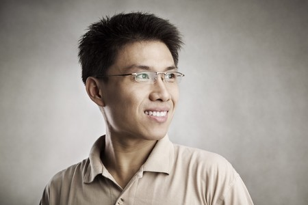 Happy Chinese man, series from several expression with vignetting and color hue in post processing Stock Photo - 7283274