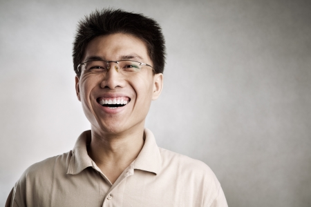 hue: Happy Chinese man, series from several expression with vignetting and color hue in post processing Stock Photo