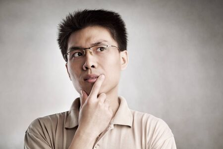 Contemplate Chinese man, series from several expression with vignetting and color hue in post processing Stock Photo - 7283322