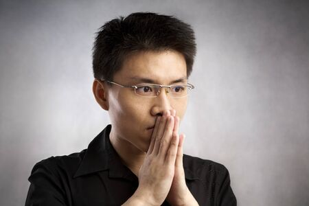 Nervous Chinese man, series from several expression with vignetting and color hue in post processing Stock Photo - 7283235