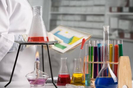 Research laboratory with scientist looking at chemical periodic table on background Stock Photo - 7284015