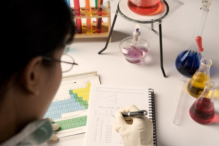 Female scientist make report in laboratory, the color temperature set a bit warm to convey late afternoon light photo