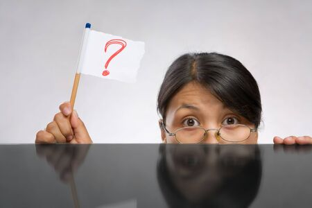 south asians: Woman holding question mark flag made of paper and pencil Stock Photo