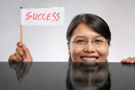 Happy woman holding success flag made of paper and pencil Stock Photo - 7283144