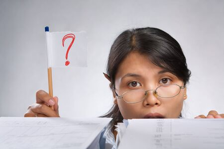 Woman holding question mark flag made of paper and pencil Stock Photo - 7283178