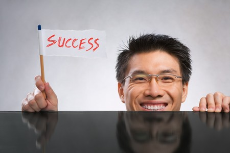 Happy man holding success flag made of paper and pencil Stock Photo - 7283140
