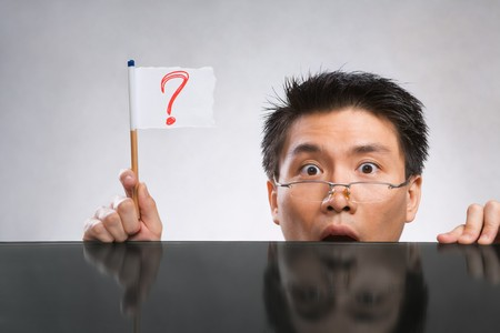 Man holding question mark flag made of paper and pencil Stock Photo - 7283133