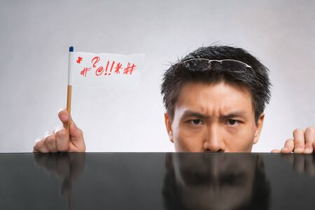 Man expressing her angry with flag made of paper and pencil Stock Photo - 7283139