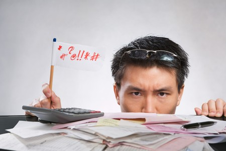 Man expressing her angry with flag made of paper and pencil with lots of bills in front of him Stock Photo - 7283192