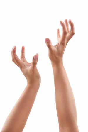 grabbing hand: Reach out hands of dark skin tone, against white background Stock Photo