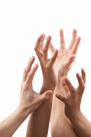 Reach out hand gesture from different skin tone hands, against white background photo