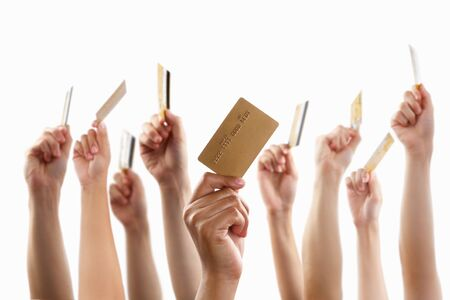 raising hand: Lot of hands raising and holding gold credit card, against white background