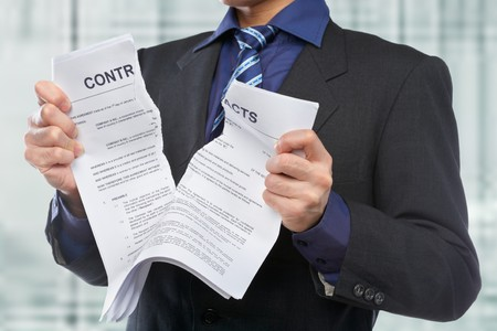 business contract: Unrecognizable businessman tearing the contract papers Stock Photo