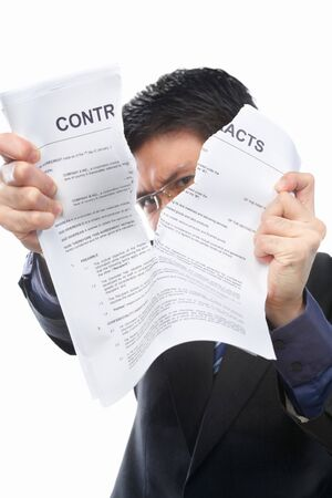 reject: Chinese businessman tearing up the contrat papers