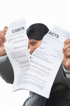 Asian businesswoman tearing up the contract papers photo