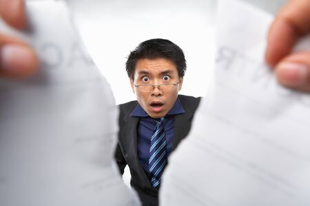 Contract refusal or rejection with shocked Chinese businesman as main focus photo