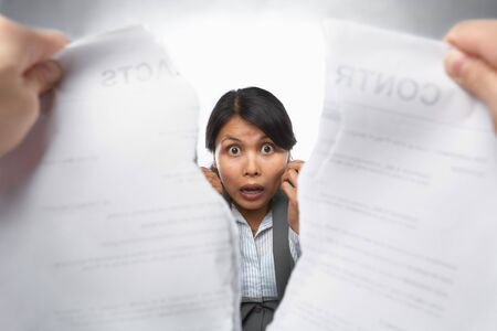 Contract refusal or rejection with shocked Asian busineswoman as main focus photo