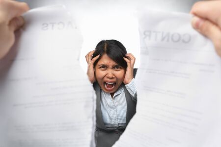 Contract refusal or rejection with frustrated Asian busineswoman as main focus photo