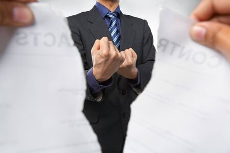 Businessman showing fighting pose when the contract tearing out photo