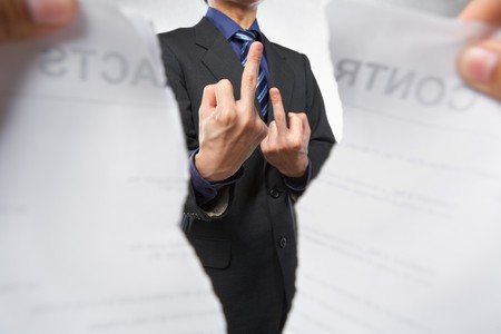 Businessman showing mid finger (flipped off) pose when the contract tearing out Stock Photo - 7283773