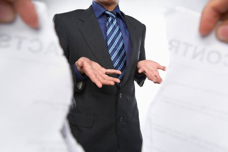 shrugged: Businessman resignedly when the contract being torn out Stock Photo