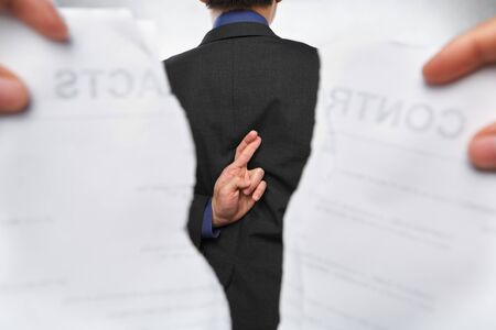 Businessman using trickery with contracts being torn out Stock Photo - 7283994