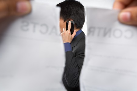 refusal: Contract refusal or rejection while the businessman on the phone Stock Photo