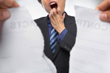 Businessman gawk and shocked when the contrat being torn out photo
